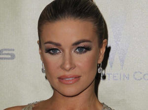 Carmen Electra silences Simon Cowell dating rumors