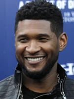 Troubles behind him, Usher kicks off music festival in London