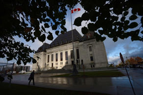A pedestrian walks past the Supreme Court of Canada in Ottawa, Oct. 18, 2013. THE CANADIAN PRESS/Sean Kilpatrick