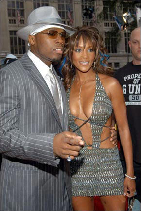 Slide 1 of 7: Silver Streak: All eyes were on 50 Cent at the VMA, and not just because he won two awards and looked impeccable in his grey pin-striped Versace suit with matching fedora (and was dripping in diamonds). No, it was because it was one of the seemingly indestructible rapper's first public appearances with new girlfriend Vivica A. Fox, who used the occasion for maximum exposure by wearing a matching silver, oh, let's say dress.
