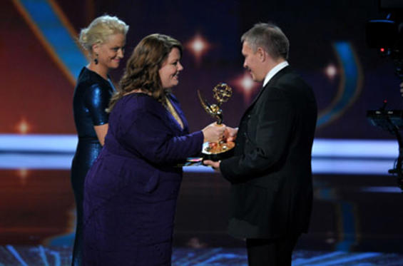 Slide 1 of 249: Actresses Amy Poehler and Melissa McCarthy present to director Brian Percival onstage during the 63rd Primetime Emmy Awards at the Nokia Theatre L.A. Live on September 18, 2011 in Los Angeles, California.