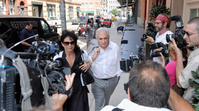 Slide 1 of 15: Former IMF Chief Dominique Strauss-Kahn (C) accompanied by his wife Anne Sinclair, arrive at their temporary residence on July 12, 2011 in the Tribeca neighborhood of New York City. The Manhattan District Attorney's office agreed to release Strauss-Kahn to his own recognizance on July 1st, 2011 after the credibility of the alleged sexual assualt victim had come into question. Strauss-Kahn was arrested on May 14th following an incident in a Midtown Hotel.