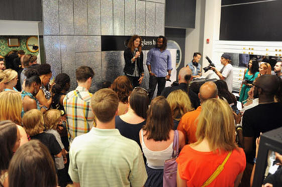 Slide 1 of 7: Shaun White (L) and Sal Masekela speak during the debut of the Oakley Holbrook collection exclusively at Sunglass Hut Flagship on July 8, 2011 in New York City.