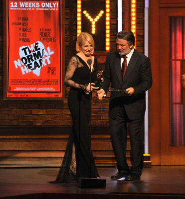 Slide 1 of 34: Ellen Barkin and Alec Baldwin on stage during the 65th Annual Tony Awards at the Beacon Theatre on June 12, 2011 in New York City.