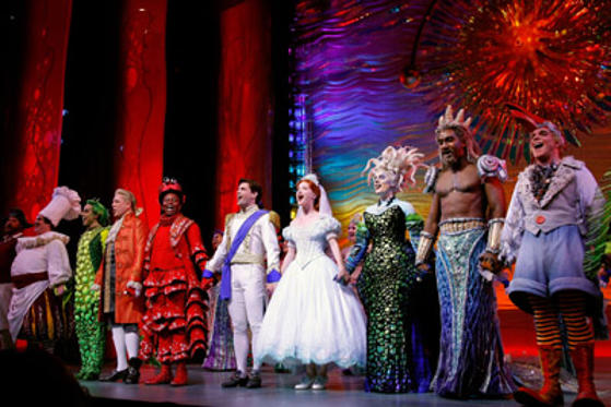 "Slide 1 of 23: Actors Jonathan Freeman, Tituss Burgess, Sean Palmer, Sierra Boggess, Sherie Rene Scott, Norm Lewis and Eddie Korbich take a bow during the curtain call at the debut of the Broadway Play ""The Little Mermaid""  at the Lunt-Fontanne Theater on January 10, 2008 in New York City"