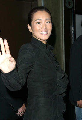 Slide 1 of 2: Gong Li with hair styled by Jie for Chanel