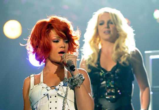 Slide 1 of 250: Singers Rihanna and Britney Spears perform onstage during the 2011 Billboard Music Awards at the MGM Grand Garden Arena May 22, 2011 in Las Vegas, Nevada.