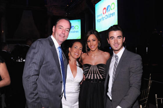 Slide 1 of 81: (L-R) Samsung Electronics America's President of Consumer Business Division Tim Baxter, guest, Danielle Jonas and Kevin Jonas attend Samsung Hope for Children Gala at Cipriani Wall Street on June 7, 2011 in New York City.