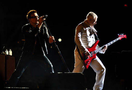 Slide 2 of 5: Bono and Adam Clayton perform during the U2 360 Tour at INVESCO Field at Mile High on May 21, 2011 in Denver, Colorado.