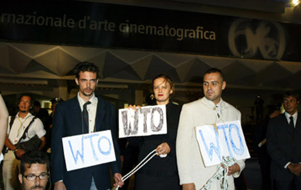 "Slide 1 of 38: Protesters demonstrate against the WTO in front of the Palazzo del Cinema before the Premiere of the German movie ""Rosenstrasse"" at the 2003 Venice Film Festival. at the Rosenstrasse premeire in Venice Lido on August 31, 2003"