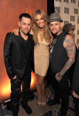 Slide 1 of 3: (L-R) Musicians Joel Madden, Delta Goodrem and Benji Madden attend the 59th Annual BMI Pop Awards at the Beverly Wilshire Four Seasons Hotel on May 17, 2011 in Beverly Hills, California.
