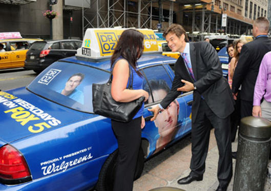 "Slide 1 of 18: Dr. Mehmet Oz (R) hails a taxi for a fan while promoting the ""The Dr. Oz Show"" new time slot at Grand Central Terminal on May 26, 2011 in New York City."