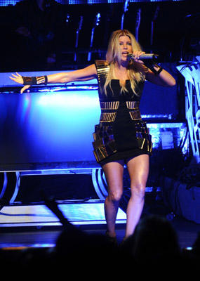 Slide 1 of 3: (Exclusive Coverage) Fergie of The Black Eyed Peas performs on stage at The Apollo Theater during Chase Presents The Black Eyed Peas Concert 4 NYC Dress Rehearsal Show Benefiting the Robin Hood Foundation on June 7, 2011 in New York City.
