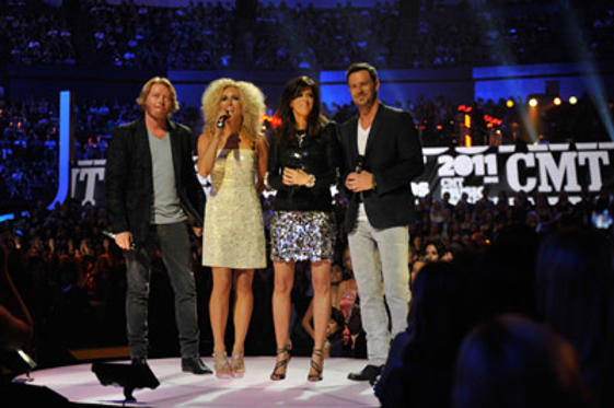 Slide 1 of 181: Musicians Phillip Sweet, Karen Fairchild, Kimberly Schlapman, and Jimi Westbrook of Little Big Town Speak on stage at the 2011 CMT Music Awards at the Bridgestone Arena on June 8, 2011 in Nashville, Tennessee.