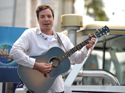 Slide 1 of 17: Actor Jimmy Fallon performs the new Universal Studio Tour theme song at Universal Studios Hollywood on June 2, 2011 in Universal City, California.