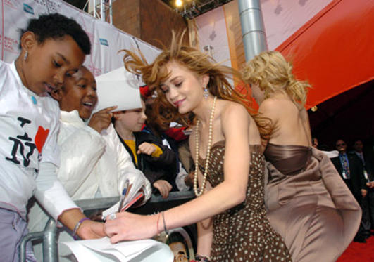 Slide 1 of 110: Mary-Kate Olsen and Ashley Olsen sign autographs at the New York Minute premiere in New York City on May 04, 2004