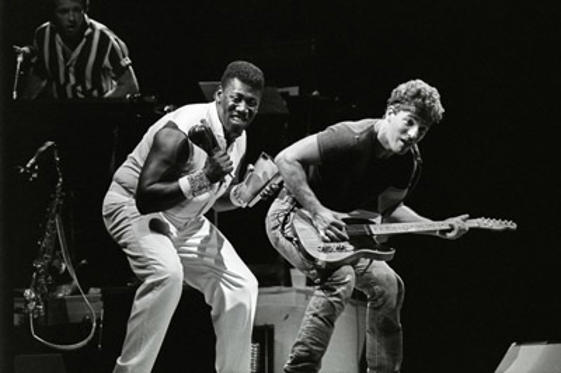 Slide 1 of 1: Clarence Clemons and Bruce Springsteen perform with The E Street Band at Giants Stadium on August 21,1985 in East Rutherford, New Jersey.