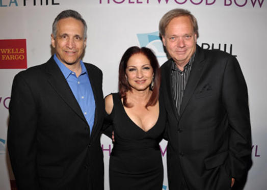 "Slide 1 of 20: Chuck Dayton, <a href=/celebrities/celebrity/gloria-estefan/ type=""Msn.Entertain.Server.WebControls.LinkableMoviePerson"" Arg=""63141"" LinkType=""Page"">Gloria Estefan</a>, and Wayne Baruch attend the Hollywood Bowl 2011 <a href=/tv/series/hall-of-fame.2/ type=""Msn.Entertain.Server.WebControls.LinkableTVSeries"" Arg=""1"" LinkType=""Page"">Hall of Fame</a> Ceremony at the Hollywood Bowl on June 17, 2011 in Hollywood, California."
