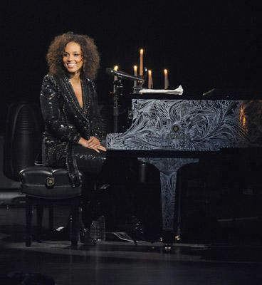 Slide 1 of 3: Musician Alicia Keys performs at The Beacon Theatre on June 30, 2011 in New York City.