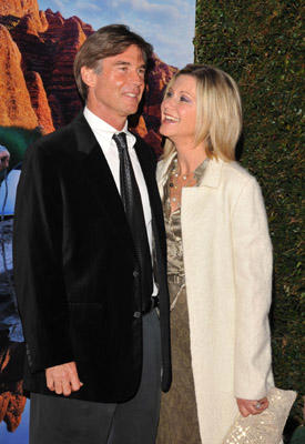 Slide 1 of 70: Actress Olivia Newton-John and guest arrive for the GDay USA Australia.com black tie gala held at the Grand Ballroom in the Hollywood & Highland Center on January 19, 2008 in Hollywood, California.