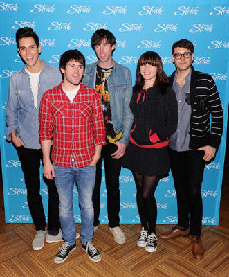 Slide 1 of 23: Gabe Saporta, Nate Novarro, Ryland Blackinton, Victoria Asher and Alex Suarez of Cobra Starship pose before their concert at the Hard Rock Cafe - Times Square on March 21, 2011 in New York City.