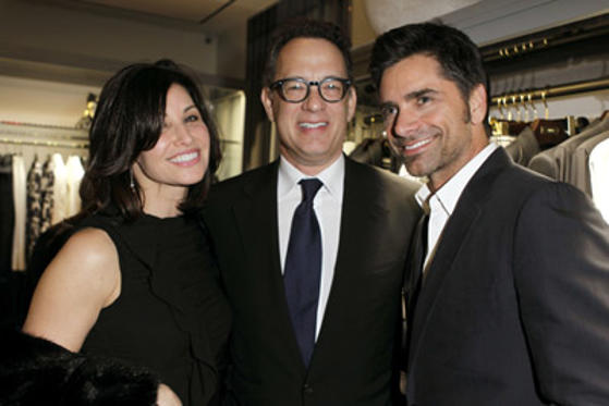 Slide 1 of 1: (EXCLUSIVE COVERAGE) Actors Gina Gershon, Tom Hanks, and John Stamos attend the TOM FORD store opening at TOM FORD Beverly Hills on February 24, 2011 in Beverly Hills, California.