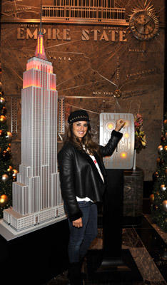 Slide 1 of 12: (Exclusive Coverage) (RED) supporter, Penelope Cruz, lights the Empire State Building (RED) on World AIDS Day, to help launch (RED)'s new awareness campaign, 'An AIDS Free Generation is Due in 2015' to highlight the possibility that by 2015 it is possible to virtually eliminate transmission of HIV from mother-to-child. Photo taken at The Empire State Building on December 1, 2010 in New York City.