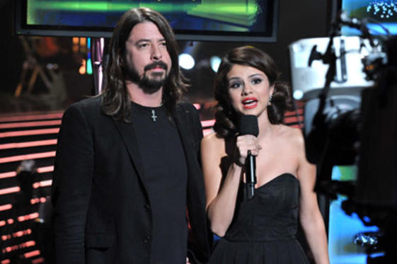 "Slide 1 of 51: Musician <a href=/celebs/celeb.aspx?c=194313 type=""Msn.Entertain.Server.WebControls.LinkableMoviePerson"" Arg=""194313"" LinkType=""Page"">Dave Grohl</a> of The <a href=/celebs/celeb.aspx?c=53163 type=""Msn.Entertain.Server.WebControls.LinkableMoviePerson"" Arg=""53163"" LinkType=""Page"">Foo Fighters</a> and actress/singer <a href=/celebs/celeb.aspx?c=582272 type=""Msn.Entertain.Server.WebControls.LinkableMoviePerson"" Arg=""582272"" LinkType=""Page"">Selena Gomez</a> speak during the GRAMMY Nominations Concert Live!! at Club Nokia on December 1, 2010 in <a href=/movies/movie.aspx?m=2296667 type=""Msn.Entertain.Server.WebControls.LinkableMovie"" Arg=""2296667"" LinkType=""Page"">Los Angeles</a>, California."