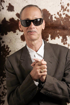 Slide 1 of 53: John Waters