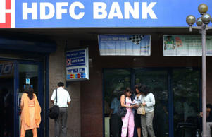 People waiting outside an HDFC bank.