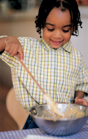 Photo: Mixing it up - Teaching children to cook lets them see which ingredients go into different foods and different meals. It also prepares them for when they eventually leave home.