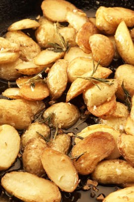 Photo: Pan-Fried Potatoes - Leftover potatoes are perfect sliced and pan-fried in olive oil with garlic and herbs.