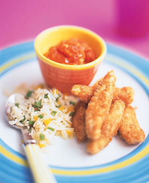 Photo: Chicken fingers - Full of protein and vitamins chicken fingers, served with a tomato sauce for dipping and rice with vegetables are fun to eat. Serve with 8floz (240ml) of low-fat milk or water.