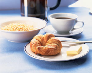 Photo: Low-fiber breakfast - This breakfast of sweetened, puffed-wheat cereal, coffee, and a croissant provides just 2.3g of fiber, as well as 27g fat and 105mg cholesterol.