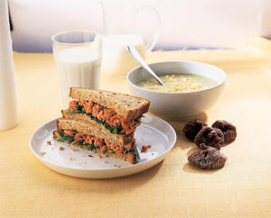 Photo: High-calcium lunch - This lunch of cream of broccoli soup topped with grated low-fat cheese, a salmon–watercress sandwich, dried figs, and a glass of low-fat milk provides 821mg of calcium.