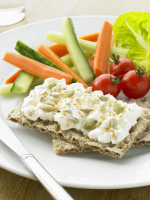 Photo: Cottage cheese on crispbread - Maintaining calcium levels is critical for arthritis sufferers, but it is important to choose low-fat dairy products to help control weight.