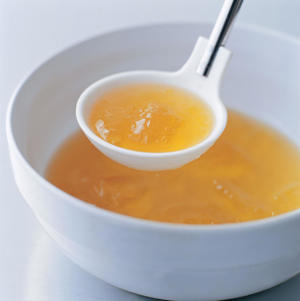 Photo: Chicken stock serves as the base for many fine soups. Some raw or cooked chicken bones and a few standard aromatics are all that's required to produce a rich, gelatinous stock.