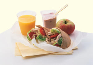 Photo: Healthy lunch - Whole-wheat pita containing sliced chicken, tomato, and lettuce is a nutritious low-fat lunch. A red apple, low-fat yogurt, and fresh orange juice are healthy choices and add vitamins, minerals, and fiber.