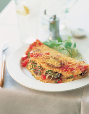 Photo: Low-fat omelet - Made with two egg whites and only one yolk, the cholesterol level of this mushroom and tomato omelet is reduced, without changing the flavor.