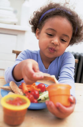 Photo: Dipping foods - Make mealtimes fun and interesting activities for children. Letting them dip food in tubs is a good way to increase the amount of vegetables they eat.
