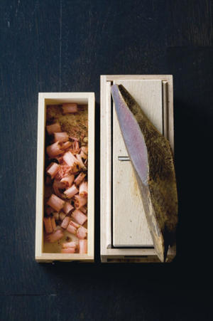 Photo: Dried whole bonito (at right) and shaved (left) in a traditional katsuobushi grater.