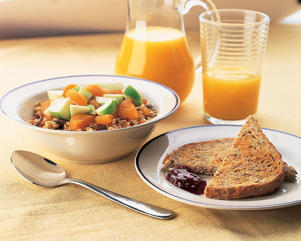 Photo: High-fiber breakfast - With whole-grain muesli and fruit, whole-grain toast, and orange juice, this version provides 12.5g fiber, 7g fat, and only 4.9mg cholesterol.