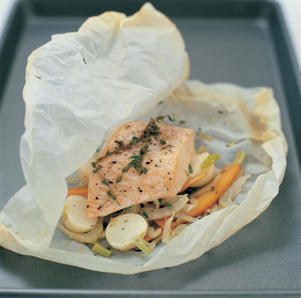 Photo: Baking En Papillote - Cooking fish en papillote , or wrapped in wax paper , with herbs and vegetables, and a splash of stock, white wine, or water, guarantees tender, moist results.