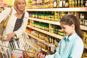 Photo: Checking ingredients - If you or your child has a lactose intolerance, it is important that you check food labels carefully and learn to spot ingredients that contain lactose.