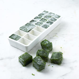 Photo: Freeze the cubes - Fill an ice cube tray with herbs and pour water over to cover. Freeze until solid, for about 2 hours. Store in labelled freezer bags until needed. Use within 6 months.