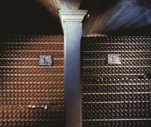 Photo: Racks of Franciacorta wine at Cavalleri