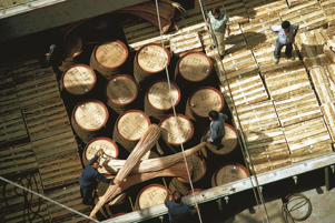 Photo: Casks of wine being loaded onto a ship at Funchal port in Madeira
