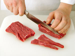 Photo: Prime cuts, like this fillet, are so tender that the direction of slicing is less important. If stir-fry strips are required, then cutting with the grain is advisable. This is not recommended for tougher cuts except when dicing.