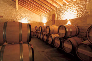 Photo: Barrel storage in the wine cellar at La Mondotte