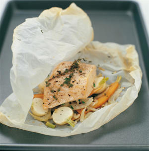 Photo: Cooking fish en papillote—in a parcel—is another gentle method of cooking fish fillets. Traditionally the parcel is made out of squares of parchment paper, but you can also wrap the fish in foil or banana leaves. Salmon fillets are particularly good cooked in this way, but cod and halibut are also suitable. Fish fillets can be packaged up with vegetables, herbs, a little white wine, or butter and must be tightly sealed to keep in all the flavors and the all-important steam. Cook them in an oven at 475°F (240°C) for 15 minutes, depending on the thickness of the fillets.